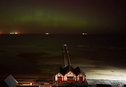 © Licensed to London News Pictures. 27/02/2014<br /> <br /> Saltburn, England<br /> <br /> The Aurora Borealis is visible over the Victorian Pier in Saltburn by the Sea in Cleveland.<br /> <br /> Photo credit : Ian Forsyth/LNP
