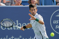 August 19, 2018 - Mason, Ohio, USA - Novak Djokovic (SRB) in action during Sunday's final round of the Western and Southern Open at the Lindner Family Tennis Center, Mason, Oh. (Credit Image: © Scott Stuart via ZUMA Wire)