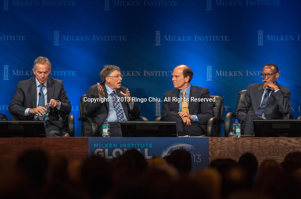 """From left to right, Tony Blair, former Prime Minister of Great Britain and Northern Ireland, Bill Gates, co-Chair and Trustee, Bill & Melinda Gates Foundation, Michael Milken, Chairman of Milken Institute, and H.E. Paul Kagame, President of the Republic of Rwanda, in a panel """"Investing in African Prosperity"""" during the Milken Institute Global Conference on Wednesday, May 1, 2013 in Beverly Hills, California. (Photo by Ringo Chiu/PHOTOFORMULA.com)."""