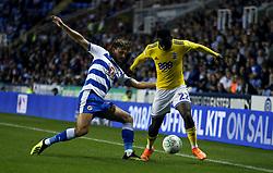 Birmingham City's Viv Solomon-Otabor and Reading's John Swift battle for the ball