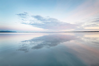 Clouds reflected in calm waters of Bellingham Bay Washington