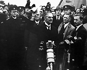 Chamberlain returning from Munich. Arthur Neville Chamberlain (1869 – 1940) British Conservative politician, Prime Minister of the United Kingdom from 1937 to May 1940. Known for his appeasement foreign policy, and in particular for his signing of the Munich Agreement in 1938, conceding the Sudetenland region of Czechoslovakia to Nazi Germany.