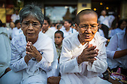 03 FEBRUARY 2013 - PHNOM PENH, CAMBODIA:  Cambodians pray on the sidewalk in front of the National Museum, site of King Norodom Sihanouk's crematorium, to honor their former King. Sihanouk ruled Cambodia from independence in 1953 until he was overthrown by a military coup in 1970. The only music being played publicly is classical Khmer music. Sihanouk died in Beijing, China, in October 2012 and will be cremated during a state funeral royal ceremony on Monday, Feb. 4.    PHOTO BY JACK KURTZ