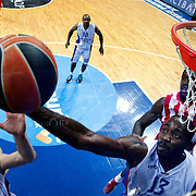 Anadolu Efes's Stephane Lasme (3ndR) during their Gloria Cup Basketball Tournament match Anadolu Efes between Olympiacos at Ulker Sports Arena in istanbul Turkey on Tuesday 23 September 2014. Photo by Aykut AKICI/TURKPIX