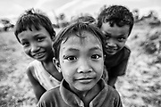 Three young Cambodian boys pose for the camera.