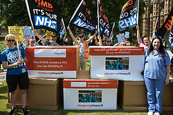 London, UK. 20th July, 2021. NHS workers from the grassroots NHSPay15 campaign prepare to march from opposite Parliament to 10 Downing Street to present a petition signed by over 800,000 people calling for a 15% pay rise for NHS workers. At the time of presentation of the petition, the government was believed to be preparing to offer NHS workers a 3% pay rise in 'recognition of the unique impact of the pandemic on the NHS'.