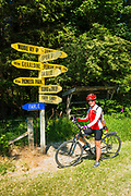 Cyclist and road sign in Middle Valley, Canterbury, South Island, New Zealand