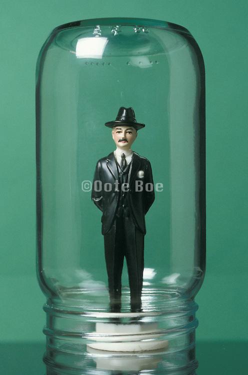 business doll under a glass jar
