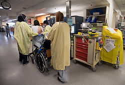 Nurses help a patient walk in the COVID-19 intensive care unit at St. Paul's hospital in downtown Vancouver, BC, Canada on Tuesday, April 21, 2020. Photo by Jonathan Hayward/CP/ABACAPRESS.COM