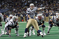 New England quarterback Tom Brady (12) points out some instructions before the snap of the ball against the St. Louis Rams, November 7, 2004.