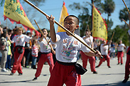 Members of the Wah Lum Performance Troupe perform for spectators along the parade route during the Dragon Parade and Lunar New Year Festival in Orlando, Fla., Sunday, Feb. 9, 2014.(Special to the Sentinel/Phelan M. Ebenhack)