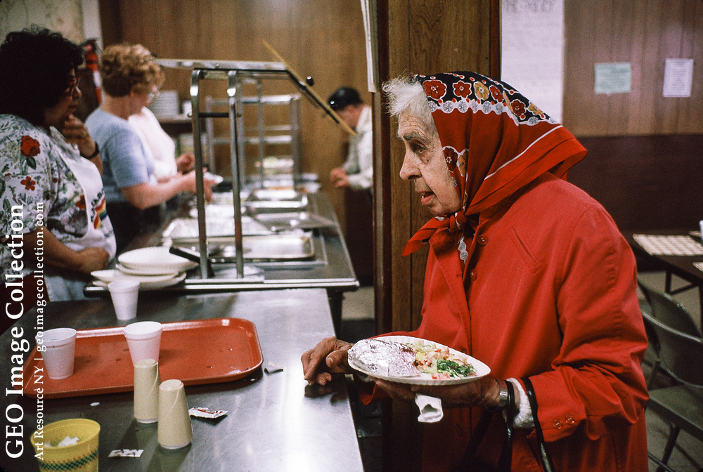 An elderly woman, receives a warm meal at Rainbow Kitchen, a food bank and charitable community clinic and cafeteria. The facility is in Homestead, a rust belt suburb of Pittsburg with high unemployment.