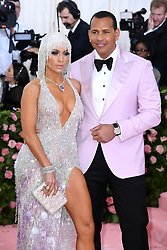 "Jennifer Lopez and Alex Rodriguez at the 2019 Costume Institute Benefit Gala celebrating the opening of ""Camp: Notes on Fashion"".<br />