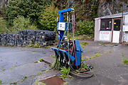 Petrol pumps stand derelict in a closed garage that once sold petrol and other vehicle accessories, on 2nd October 2021, in Blaenau Ffestiniog, Gwynedd, Wales.
