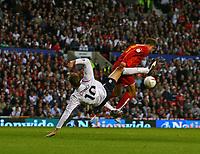 Photo: Andrew Unwin.<br />England v Macedonia. UEFA European Championships 2008 Qualifying. 07/10/2006.<br />England's Peter Crouch (L) battles with Macedonia's Igor Mitreski.