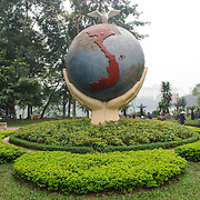 "An art sculpture of a globe with hands and a dove on the shore of Hoan Kiem Lake in Hanoi, Vietnam. The sculpture is titled ""Hope & Love for Peace."""