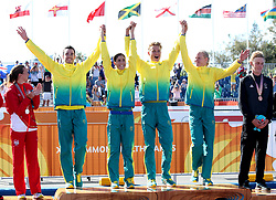 Australia's (left) Jacob Birtwhistle, Ashleigh Gentle, Matthew Hauser and Gillian Backhouse celebrate winning gold during the Mixed Team Relay Triathlon final at the Southport Broadwater Parklands during day three of the 2018 Commonwealth Games in the Gold Coast, Australia.