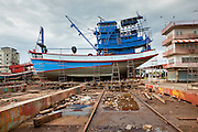 Sept. 24, 2009 -- PATTANI, THAILAND: A fishing boat waits to be refurbished in the Siriudom Shipyard in Pattani, Thailand. Fishing is the main industry in Pattani, one of just three Thai provinces with a Muslim majority. Thousands of people, mostly Buddhist Thais and Burmese Buddhist immigrants, are employed in the fishing industry, either crewing ships, working in processing plants or working in the ship building and refreshing yards.   Photo By Jack Kurtz