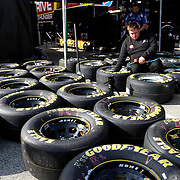 Crew members prepare race tires in the pits during the practice session prior to the NASCAR Sprint Unlimited Race at Daytona International Speedway on Saturday, February 16, 2013 in Daytona Beach, Florida.  (AP Photo/Alex Menendez)