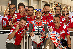 September 22, 2018 - Alcaniz, Teruel, Spain - Andrea Dovizioso (4) of Italy and Ducati Team celebrates whit his teammates after qualifying for the Gran Premio Movistar de Aragon of world championship of MotoGP at Motorland Aragon Circuit on September 22, 2018 in Alcaniz, Spain. (Credit Image: © Jose Breton/NurPhoto/ZUMA Press)