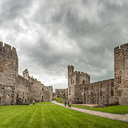 A panorama of the interior courtyard at Caernarfon Castle in northwest Wales. A castle originally stood on the site dating back to the late 11th century, but in the late 13th century King Edward I commissioned a new structure that stands to this day. It has distinctive towers and is one of the best preserved of the series of castles Edward I commissioned.