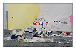 Yachting- The first days inshore racing  of the Bell Lawrie Scottish series 2003 at Tarbert Loch Fyne.  Light shifty winds dominated the racing...SB3 winner Laser Scottish Office overtaking the quarter wave of David Maguire in Martin Reilly Motors, IRL1803, ..Pics Marc Turner / PFM