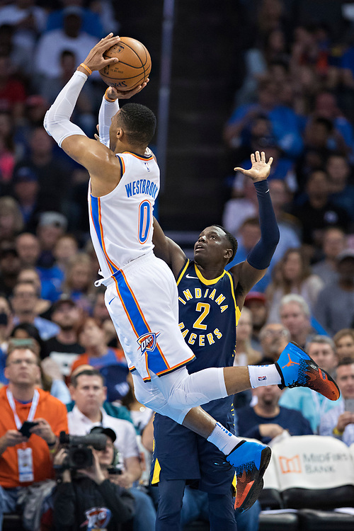 OKLAHOMA CITY, OK - OCTOBER 25:  Russell Westbrook #0 of the Oklahoma City Thunder goes up for a jump shot over Darren Collison #2 of the Indiana Pacers at the Chesapeake Energy Arena on October 25, 2017 in Oklahoma City, Oklahoma.  NOTE TO USER: User expressly acknowledges and agrees that, by downloading and or using this photograph, User is consenting to the terms and conditions of the Getty Images License Agreement.  The Thunder defeated the Pacers 114-96.  (Photo by Wesley Hitt/Getty Images) *** Local Caption *** Carmelo Anthony; Darren Collison