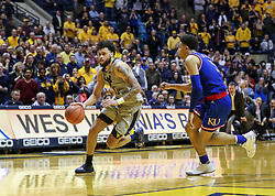 Jan 19, 2019; Morgantown, WV, USA; West Virginia Mountaineers guard Jermaine Haley (10) drives to the basket in the final seconds against the Kansas Jayhawks at WVU Coliseum. Mandatory Credit: Ben Queen-USA TODAY Sports