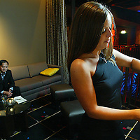 (PFEATURES) Atlantic City 10/23/2003  High Roller James Kwasnik sits in the private room of Club MIXX in the Borgata Hotel and Casino as hostess ______ makes a martini.     Michael J. Treola Staff Photographer....MJT