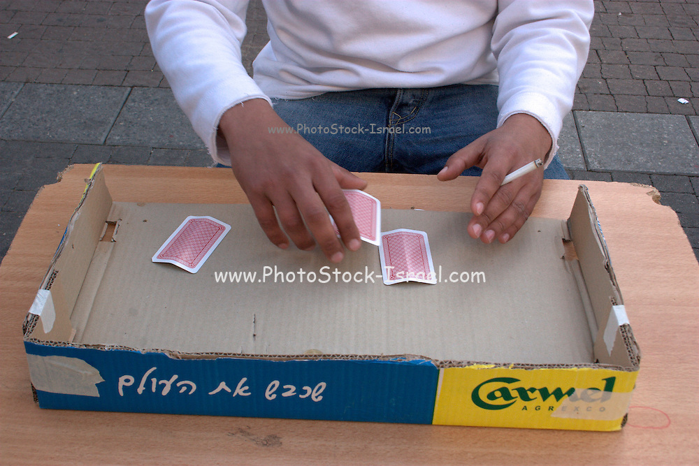 Three-card Monte, also known as the Three-card marney, Three-card trick, Three-Way, Three-card shuffle, Triplets, Follow the lady, Find the lady, or Follow the Bee