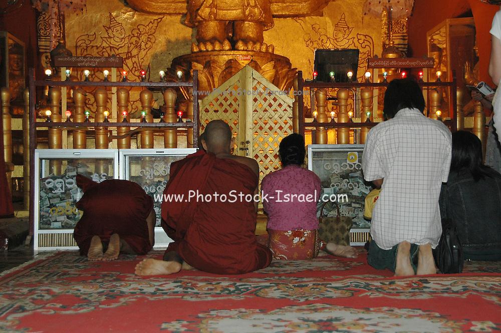 Myanmar Mandalay Hill praying in the Shwenandaw Monastery