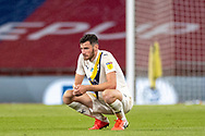 Oxford United defender Elliott Moore (5) looks crushed at full time during the EFL Sky Bet League 1 Play Off Final match between Oxford United and Wycombe Wanderers at Wembley Stadium, London, England on 13 July 2020.