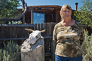 Shirley McNall, who goes by Sugar in front of a her home in Aztec New Mexico. Sugar  leads a tour of toxic sites in the San Juan basin in the hopes of educating people to the dangers of the fracking industry.