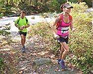 Kerhonkson, New York - Amy Hanlon and Marcus Guiliano run along the trail at Minnewaska State Park Preserve during the Shawangunk Ridge Trail Run/Hike 32-mile race  on Sept. 20, 2014.