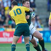 Quade Cooper, Australia, tackles South African captain John Smit,  during the South Africa V Australia Quarter Final match at the IRB Rugby World Cup tournament. Wellington Regional Stadium, Wellington, New Zealand, 9th October 2011. Photo Tim Clayton...