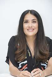 June 14, 2017 - Hollywood, California, U.S. - SALMA HAYEK promotes 'Beatriz at Dinner.' Salma Hayek (born September 2, 1966) is a Mexican-American film actress, producer, and former model. She began her career in Mexico starring in the telenovela Teresa and starred in the film El Callejon de los Milagros (Miracle Alley) for which she was nominated for an Ariel Award. In 1991 Hayek moved to Hollywood and came to prominence with roles in movies such as Desperado (1995), From Dusk Till Dawn (1996), Dogma (1999), and Wild Wild West (1999). Her breakthrough role was in the 2002 film Frida as Mexican painter Frida Kahlo for which she was nominated in the category of Best Actress for an Academy Award, BAFTA Award, Screen Actors Guild Award, and Golden Globe Award. This movie received widespread attention and was a critical and commercial success. She won a Daytime Emmy Award for Outstanding Directing in a Children/Youth/Family Special in 2004 for The Maldonado Miracle and received an Emmy Award nomination for Outstanding Guest Actress in a Comedy Series in 2007 after guest-starring in the ABC television comedy-drama Ugly Betty. She also guest-starred on the NBC comedy series 30 Rock from 2009 to 2013. Hayek's recent films include Grown Ups (2010), Puss in Boots (2011), Grown Ups 2 (2013), and Tale of Tales (2015).The Hitman's Bodyguard (2017), How to Be a Latin Lover (2017), Drunk Parents (2017), Beatriz at Dinner (2017). (Credit Image: © Armando Gallo via ZUMA Studio)