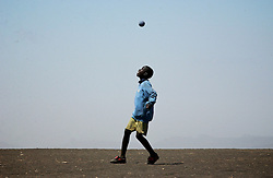 Children play football at the Endolin Primary school in Ngornogoro District in Tanzania September 30, 2003. The Masai were thrown out of the Crater in 1972 and struggle to hang onto the lands they live on now because of increasing pressure from conservationists. (Ami Vitale)