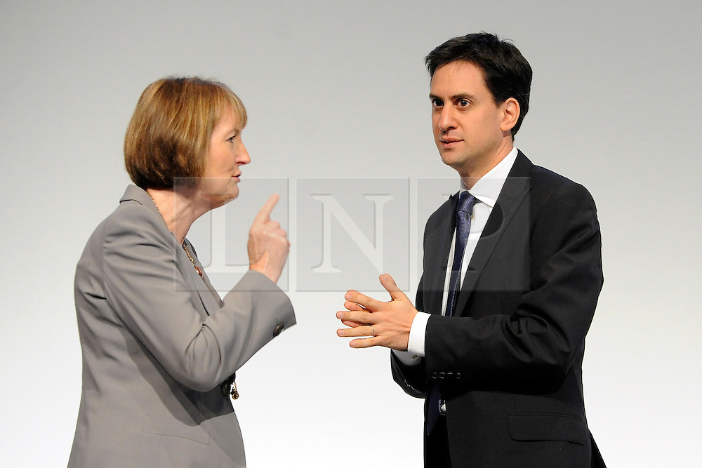 © Licensed to London News Pictures. 29/09/2011. LONDON, UK. Harriet Harman MP, Deputy Leader of the Labour Party talks to Ed Miliband, Leader of the Labour Party at The Labour Party Conference in Liverpool today (2829/09/11). Photo credit:  Stephen Simpson/LNP