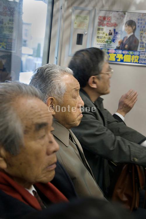 elderly businessmen commuters Tokyo Japan