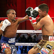 Jonathan Gonzalez lands a shot the head of Richard Rodriguez during a Telemundo boxing match between at Osceola Heritage Park on Friday, February 23, 2018 in Kissimmee, Florida.  (Alex Menendez via AP)
