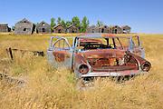 Abandonned car and graneries<br /> Rosetown<br /> Saskatchewan<br /> Canada