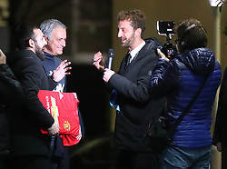 Manchester United Manager Jose Mourinho is ambushed by reporters from Italian TV as he arrives back at The Lowry Hotel on Wednesday evening. Alessandro Onnis and Stefano Corti from the show Le iene€ on Italian Tv Channel €œItalia 1€ jumped out of their car and ran up the steps of The Lowry Hotel at about 5.15pm and started asking Mourinho questions and he seemed happy enought to talk. When the interview ended they asked Mourinho to sign a Man United shirt, which he did. They then turned the shirt over to reveal that No1 Antonio Conte written on it. Mourinho took the gag in good spirits and walked into the hotel.