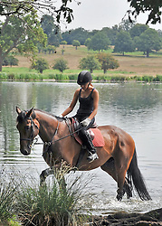 © licensed to London News Pictures. RICHMOND, UK.  02/08/11. A horse rider walks her horse through water in order to cool it off. People and animals in the hot sun today (2nd August 2011) in Richmond Park, Surrey. Temperatures are set to reach 30 degrees Celsius in some parts of London over the next few days.  Mandatory Credit Stephen Simpson/LNP