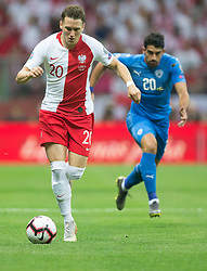 June 10, 2019 - Warsaw, Poland - Piotr Zielinski of Poland vies Omri Ben Harush (ISR) during the UEFA Euro 2020 qualifier Group G football match Poland against Israel on June 10, 2019 in Warsaw, Poland. (Credit Image: © Foto Olimpik/NurPhoto via ZUMA Press)