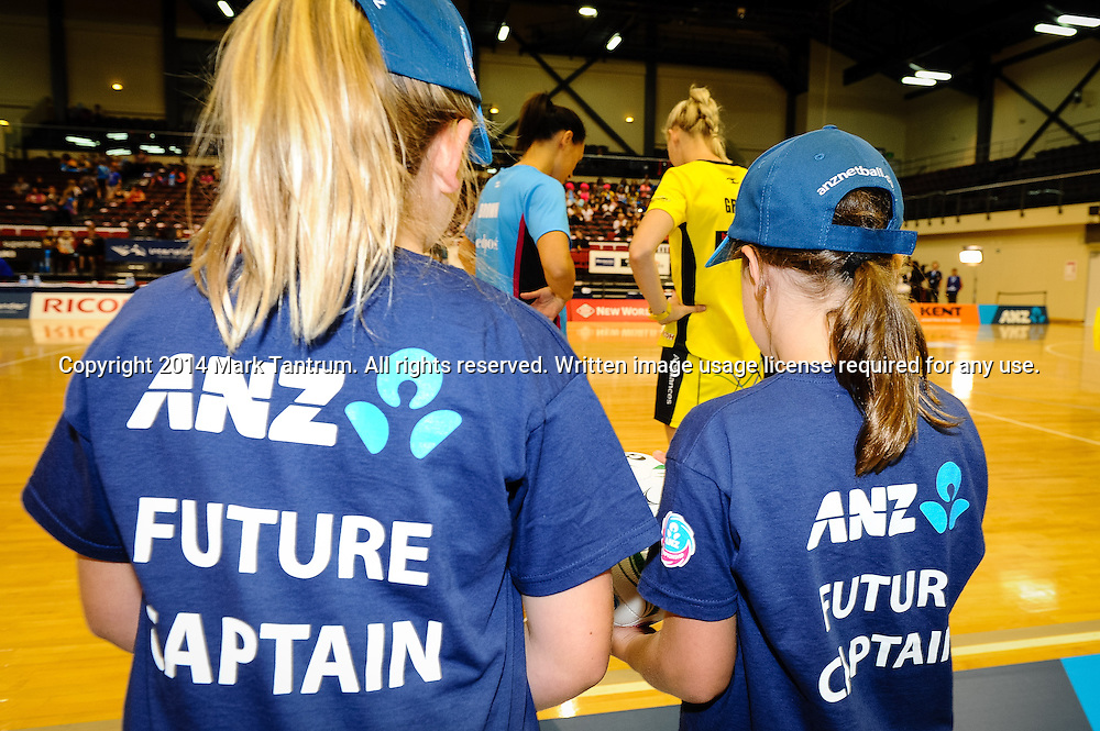 Future Captains Veava-Mei Hammond (left) and Nina Newdick (right) watch the coin toss between Southern Steel captain Jodi Brown and Pulse captain Katrina Grant. ANZ Championship - Pulse v Southern Steel netball match. TSB Arena, Wellington, New Zealand. Saturday 8 March 2014. Photo: Mark Tantrum