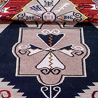 A rug woven by Helene Nez claimed the Best in Show prize for the Gallup Intertribal Indian Ceremonial Monday in the exhibit hall at Red Rock Park in Gallup.