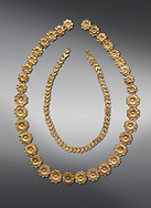 Mycenaean gold necklace from the Mycenaean cemetery of Midea tholos tomb , Dendra, Greece. National Archaeological Museum Athens. Grey Background<br /> <br /> Inside mycenaean necklace has gold ivy leaf beads, Cat No 7354. The outer mycenaean necklace has rosette shaped gold beads, Cat No 7342. 15th-14th century BC. .<br /> <br /> If you prefer to buy from our ALAMY PHOTO LIBRARY  Collection visit : https://www.alamy.com/portfolio/paul-williams-funkystock/mycenaean-art-artefacts.html . Type -   Athens    - into the LOWER SEARCH WITHIN GALLERY box. Refine search by adding background colour, place, museum etc<br /> <br /> Visit our MYCENAEN ART PHOTO COLLECTIONS for more photos to download  as wall art prints https://funkystock.photoshelter.com/gallery-collection/Pictures-Images-of-Ancient-Mycenaean-Art-Artefacts-Archaeology-Sites/C0000xRC5WLQcbhQ