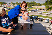 16 JULY 2021 - ALTOONA, IOWA: Congressperson CINDY AXNE (D - IA 3rd District) hugs a constituent during a town hall meeting at the Brick and Ivy Rooftop in Altoona. About 25 people attended the meeting. Axne is the only Democratic Congressperson from Iowa. Axne has not decided yet if she is going to run for reelection in 2022, but three Republicans have already declared their intention to run for the seat. Her set will probably be the most contested congressional seat in Iowa.       PHOTO BY JACK KURTZ