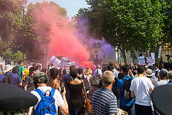 London, June 21st 2017. Protesters march through London from Sheherd's Bush Green in what the organisers call 'A Day Of Rage' in the wake of the Grenfell Tower fire disaster. The march is organised by the Movement for Justice By Any Means Necessary and coincides with the Queen's Speech at Parliament, the destination. PICTURED: Smoke bombs are ignited outside Downing Street.