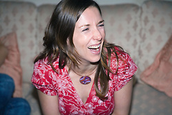 Portrait of young woman laughing,